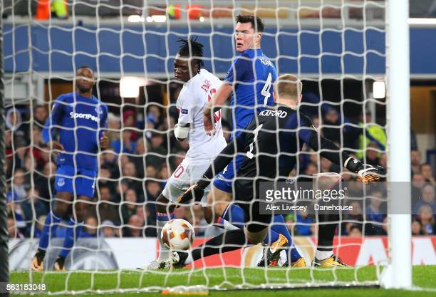 Bertrand Traore of Olympique Lyon scores their second goal past Jordan Pickford of Everton FC during the UEFA Europa League group E match between...