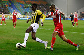 Bertrand Traore of Vitesse and Simon Poulsen of AZ battle for the ball during the Dutch Eredivisie match between Vitesse Arnhem and AZ Alkmaar held...