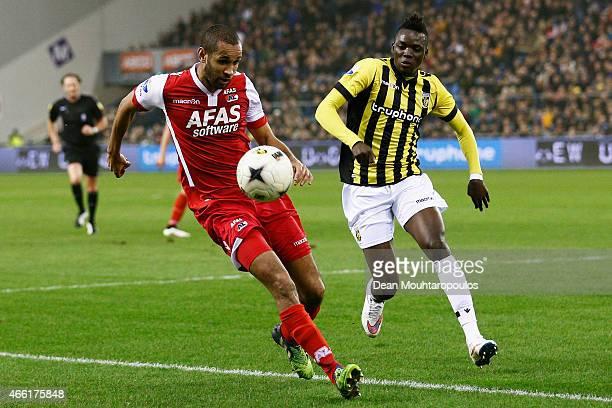 Bertrand Traore of Vitesse and Simon Poulsen of AZ battle for the ball during the Dutch Eredivisie match between Vitesse Arnhem and AZ Alkmaar held...