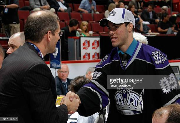F Berube shakes hands with General Manager Ron Hextall of the Los Angeles Kings after being drafted 95th overall during the second day of the 2009...