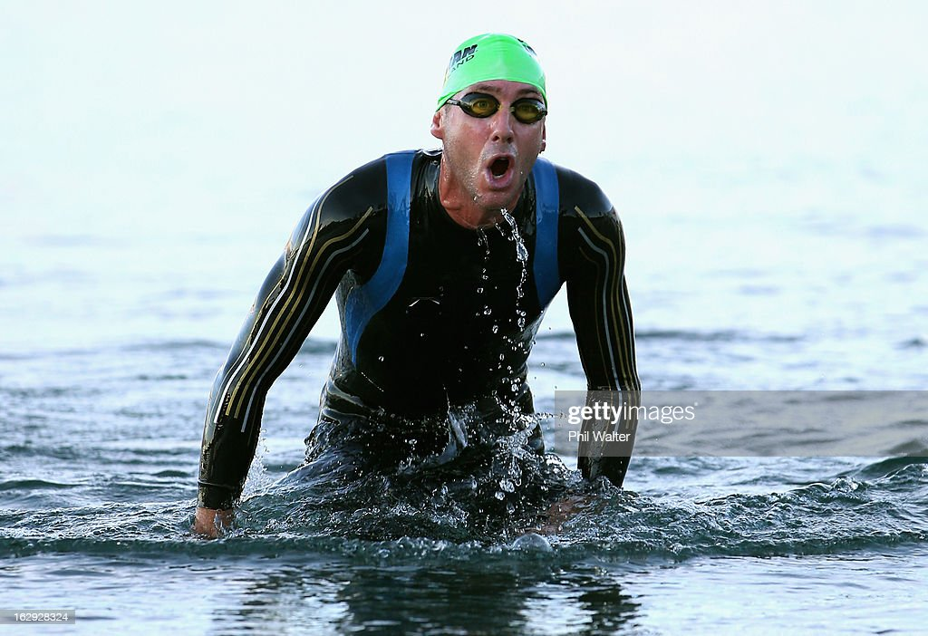 Bervan Docherty of New Zealand exits the water after the swim leg during the New Zealand Ironman on March 2, 2013 in Taupo, New Zealand.