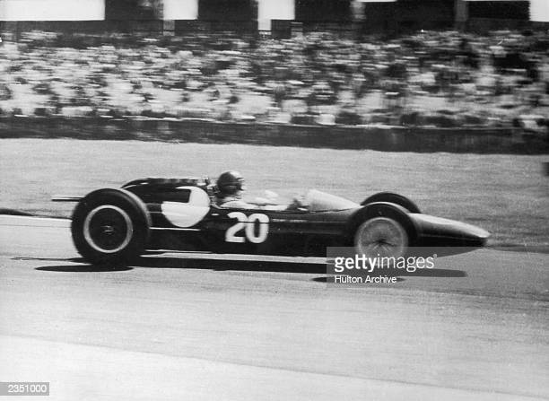 Berwickshire farmer Jim Clark shoots into the lead with his Lotus 25 to win the 225mile British Grand Prix at Aintree 23rd July 1962