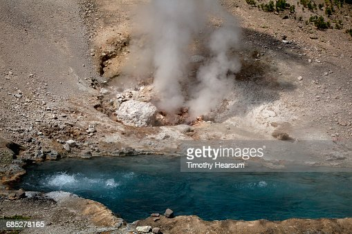 Beryl Spring, a bubbling pool with steam rising : Stock Photo