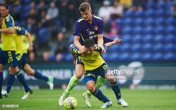 Besar Halimi of Brondby IF and Alexander Sorloth of FC Midtjylland compete for the ball during the Danish Alka Superliga match between Brondby IF and...