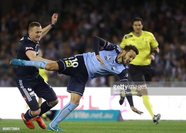 Besart Barisha of the Victory collides with Milos Ninkovic of Sydney FC during the round one ALeague match between the Melbourne Victory and Sydney...