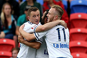 Besart Berisha and Connor Pain of the Victory celebrate a goal during the round 13 ALeague match between the Newcastle Jets and Melbourne Victory at...