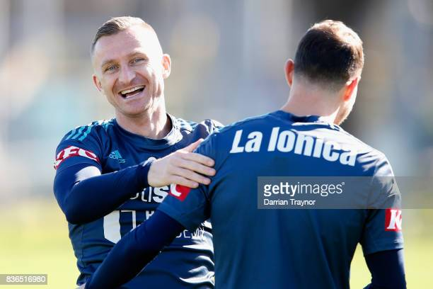 Besart Berisha and James Troisi of the Victory share a laugh during a Melbourne Victory training session at AAMI Park on August 22 2017 in Melbourne...