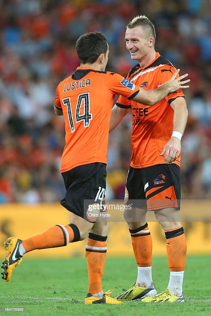 Besart Berisha and Steven Lustica of the Roar celebrate after scoring a goal during the round 27 A-League match between the Brisbane Roar and Sydney FC at Suncorp Stadium on March 28, 2013 in Brisbane, Australia.