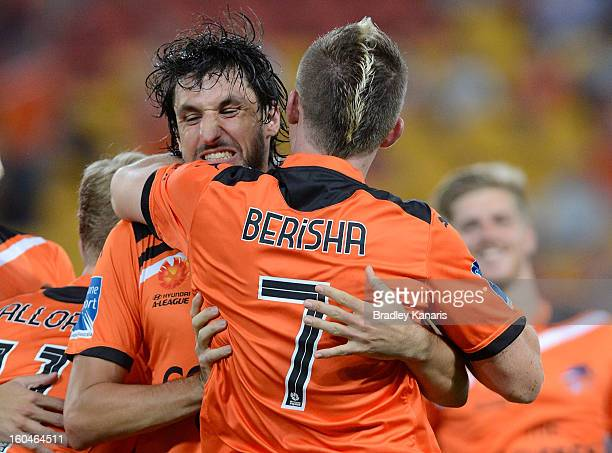 Besart Berisha and Thomas Broich of the Roar celebrate a goal during the round 19 ALeague match between the Brisbane Roar and the Central Coast...