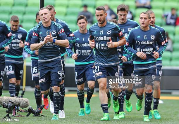 Besart Berisha Carl Valeri and Alan Baro of the Victory warm up during the ALeague Semi Final match between Melbourne Victory and the Brisbane Roar...