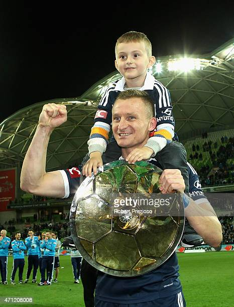 Besart Berisha of Melbourne holds the premiers plate as Melbourne Victory wins the premiers plate during the round 27 ALeague match between the...