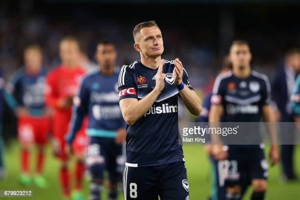 Besart Berisha of Melbourne Victory and team mates look dejected after losing the penalty shoot out during the 2017 ALeague Grand Final match between...