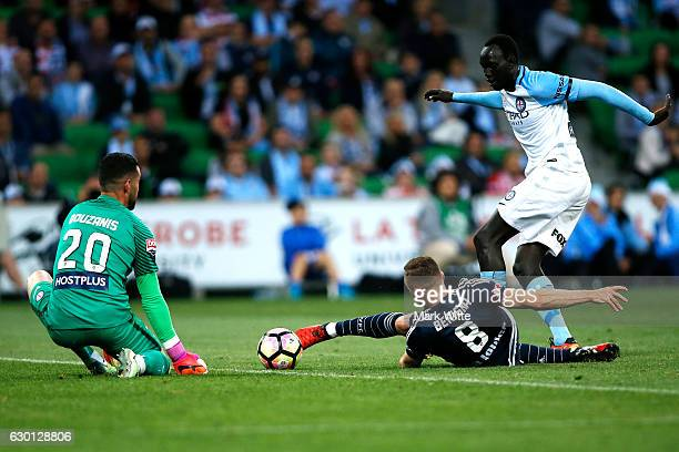 Besart Berisha of Melbourne Victory attempts to score a goal against Dean Bouzanis of Melbourne City during the round 11 ALeague match between...