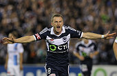 Besart Berisha of Melbourne Victory celebrates his goal during the round three ALeague match between the Melbourne Victory and Melbourne City at...