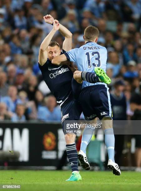 Besart Berisha of Melbourne Victory is challenged by Brandon O'Neill of Sydney FC during the 2017 ALeague Grand Final match between Sydney FC and the...