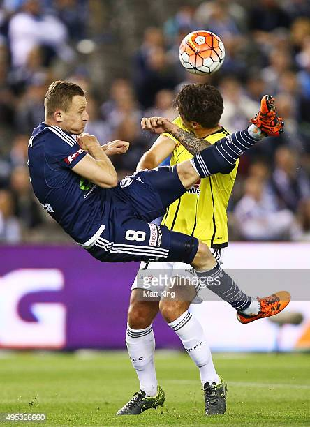 Besart Berisha of Melbourne Victory is challenged by Tom Doyle of Wellington Phoenix during the round four ALeague match between the Melbourne...