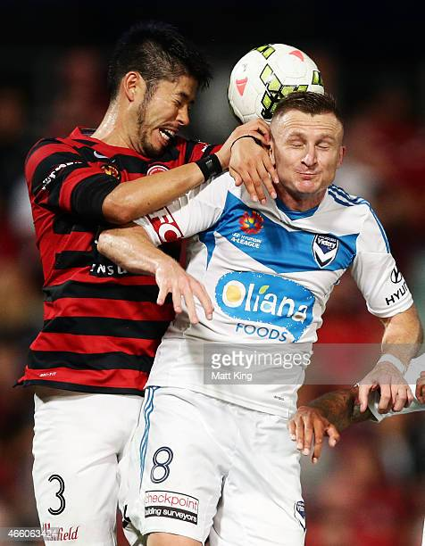 Besart Berisha of Melbourne Victory is challenged by Yusuke Tanaka of the Wanderers during the round 21 ALeague match between the Western Sydney...