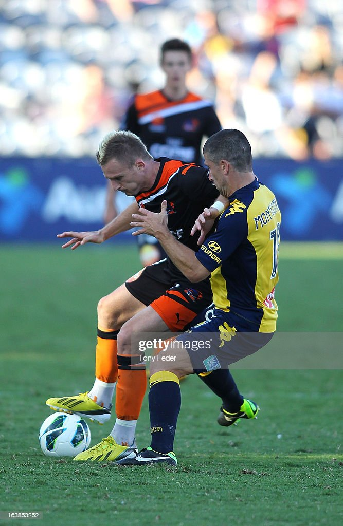 <a gi-track='captionPersonalityLinkClicked' href=/galleries/search?phrase=Besart+Berisha&family=editorial&specificpeople=737057 ng-click='$event.stopPropagation()'>Besart Berisha</a> of the Brisbane Roar and <a gi-track='captionPersonalityLinkClicked' href=/galleries/search?phrase=Nick+Montgomery&family=editorial&specificpeople=687409 ng-click='$event.stopPropagation()'>Nick Montgomery</a> of the Mariners contest thee ball during the round 25 A-League match between the Central Coast Mariners and the Brisbane Roar at Bluetongue Stadium on March 17, 2013 in Gosford, Australia.
