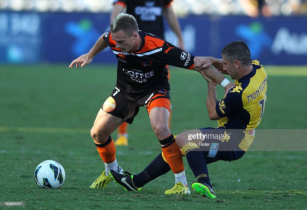 <a gi-track='captionPersonalityLinkClicked' href=/galleries/search?phrase=Besart+Berisha&family=editorial&specificpeople=737057 ng-click='$event.stopPropagation()'>Besart Berisha</a> of the Brisbane Roar tries to escape the clutches of <a gi-track='captionPersonalityLinkClicked' href=/galleries/search?phrase=Nick+Montgomery&family=editorial&specificpeople=687409 ng-click='$event.stopPropagation()'>Nick Montgomery</a> of the Mariners during the round 25 A-League match between the Central Coast Mariners and the Brisbane Roar at Bluetongue Stadium on March 17, 2013 in Gosford, Australia.