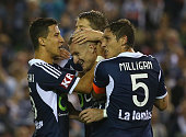 Besart Berisha of the Melbourne Victory celebrates wit teammates after an own goal by Jade North of the Brisbane Roar during the round seven ALeague...
