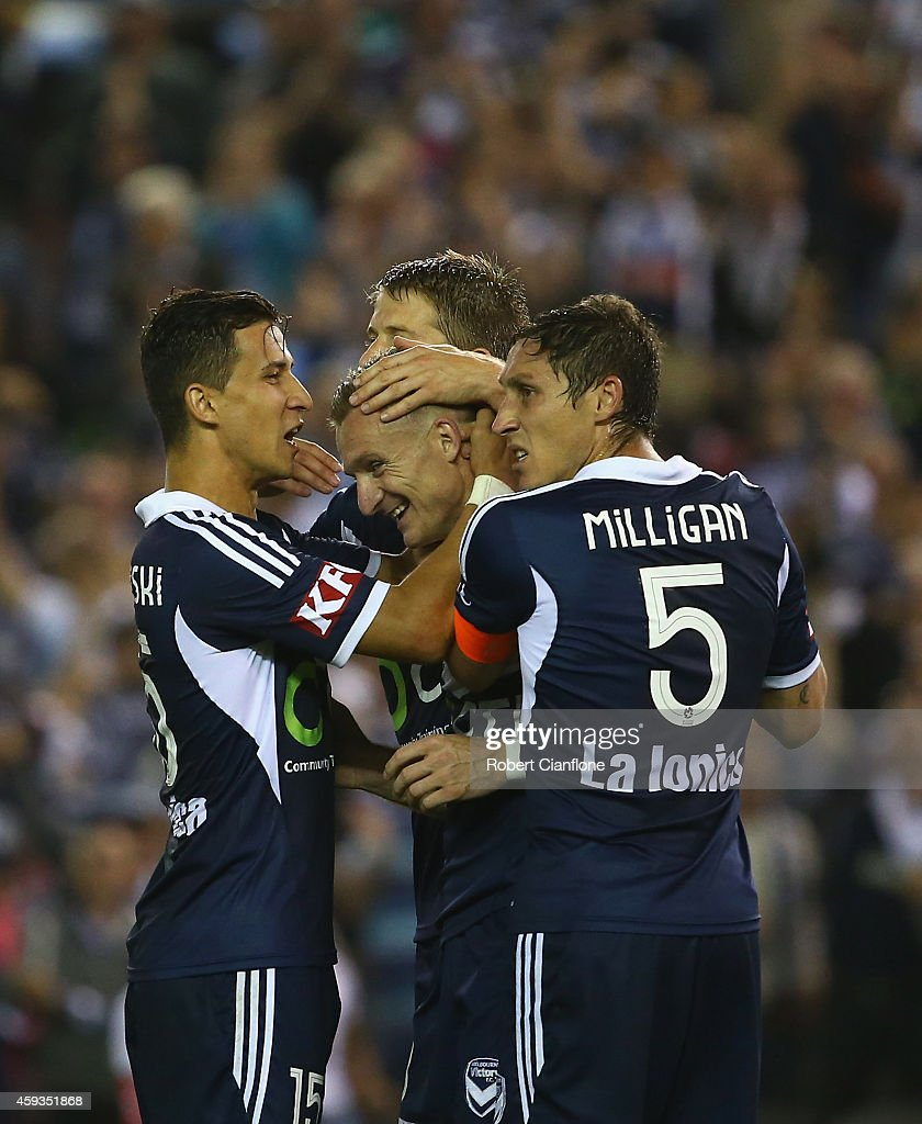 Besart Berisha of the Melbourne Victory celebrates with teammates after an own goal by Jade North of the Brisbane Roar during the round seven ALeague...