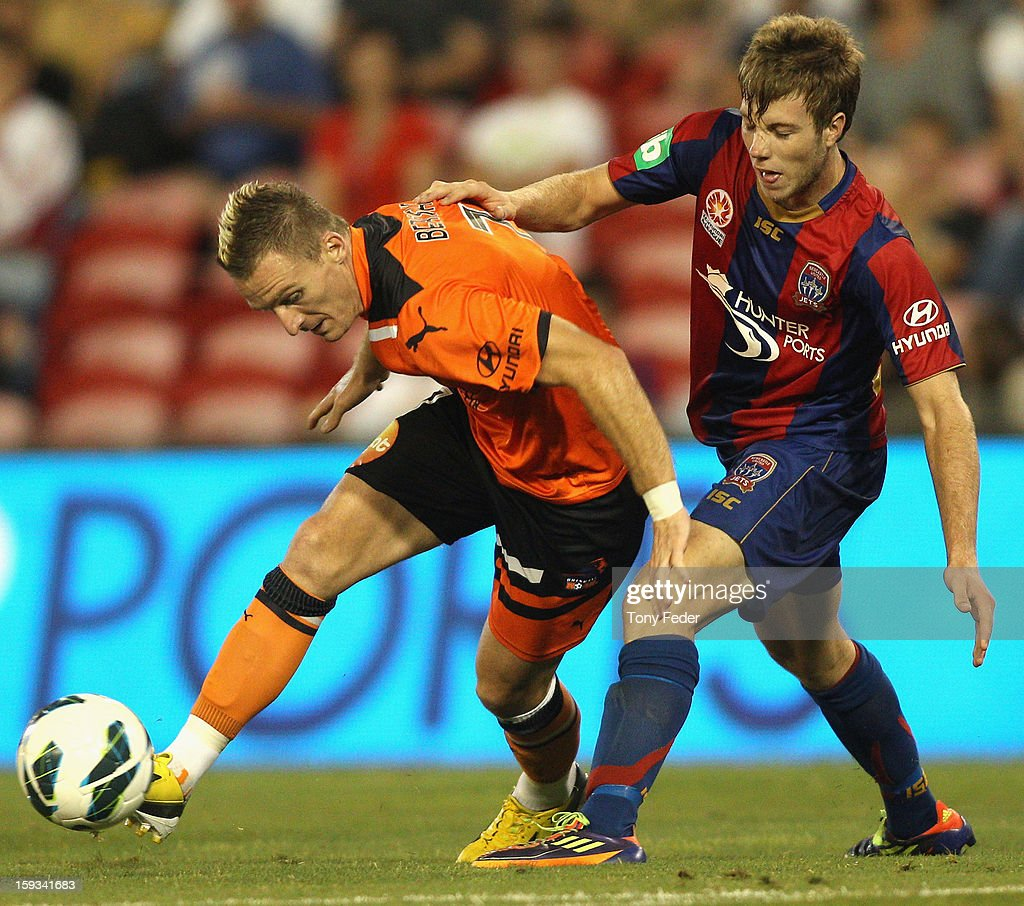 Besart Berisha of the Roar and Andrew Hoole (R) of the Jets contest the ball during the round 16 A-League match between the Newcastle Jets and the Brisbane Roar at Hunter Stadium on January 12, 2013 in Newcastle, Australia.