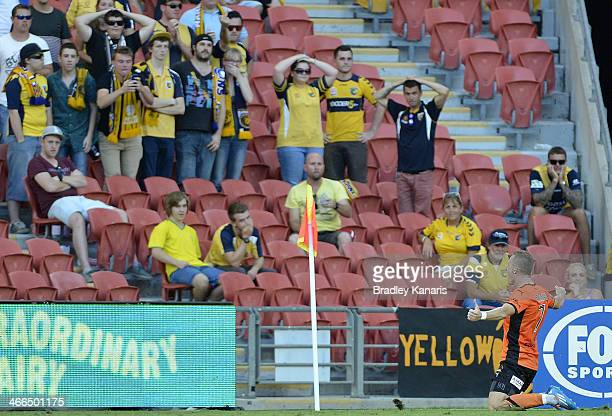 Besart Berisha of the Roar celebrates as Mariners fans show their disappointment during the round 17 ALeague match between Brisbane Roar and the...