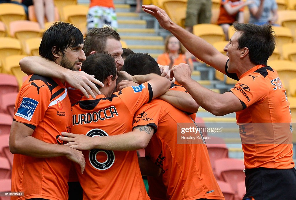Besart Berisha of the Roar celebrates with team mates after scoring a goal during the round 21 A-League match between the Brisbane Roar and the Wellington Phoenix at Suncorp Stadium on February 17, 2013 in Brisbane, Australia.