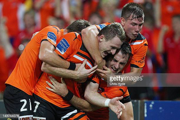 Besart Berisha of the Roar celebrates with team mates after scoring his second goal during the 2012 ALeague Grand Final match between the Brisbane...
