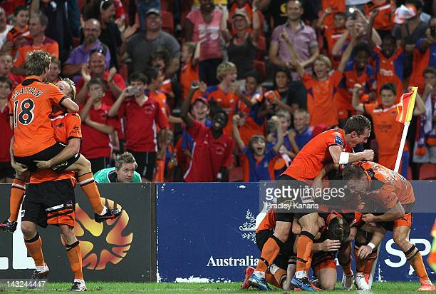 Besart Berisha of the Roar celebrates with team mates after scoring the winning goal during the 2012 ALeague Grand Final match between the Brisbane...