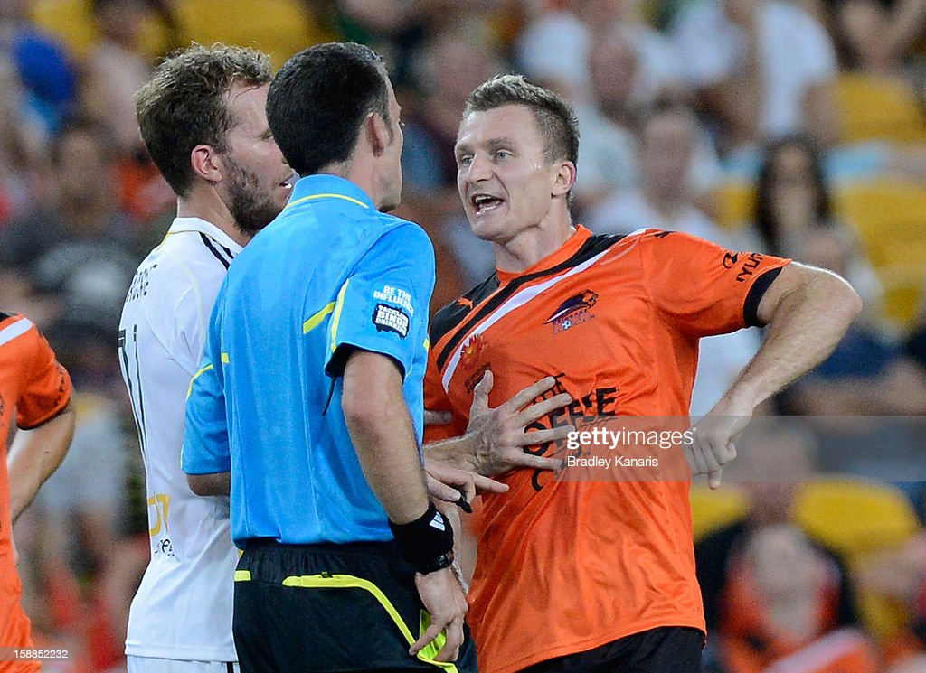 <a gi-track='captionPersonalityLinkClicked' href=/galleries/search?phrase=Besart+Berisha&family=editorial&specificpeople=737057 ng-click='$event.stopPropagation()'>Besart Berisha</a> of the Roar complains to referee Tim McGilchrist about being elbowed by an opposition player during the round 14 A-League match between the Brisbane Roar and the Wellington Phoenix at Suncorp Stadium on January 1, 2013 in Brisbane, Australia.