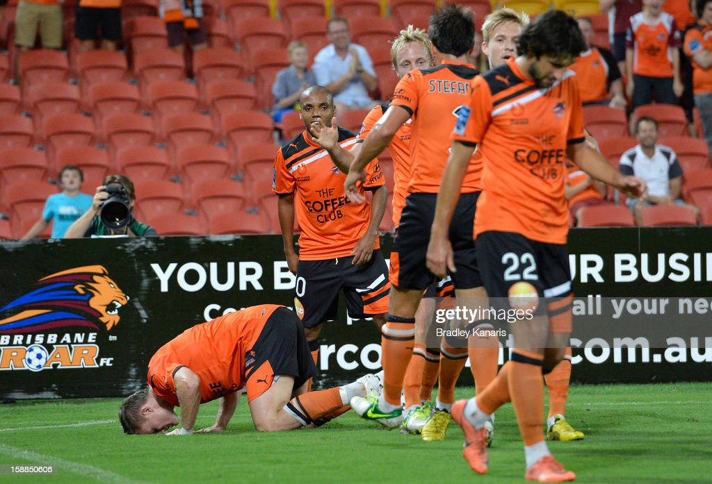Besart Berisha of the Roar kisses the ground as he celebrates scoring a goal during the round 14 A-League match between the Brisbane Roar and the Wellington Phoenix at Suncorp Stadium on January 1, 2013 in Brisbane, Australia.