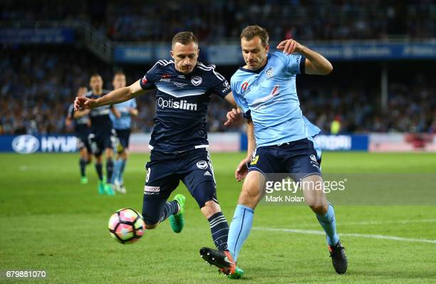 Besart Berisha of the Victory and Alex Wilkinson of Sydney FC contest possession during the 2017 ALeague Grand Final match between Sydney FC and the...