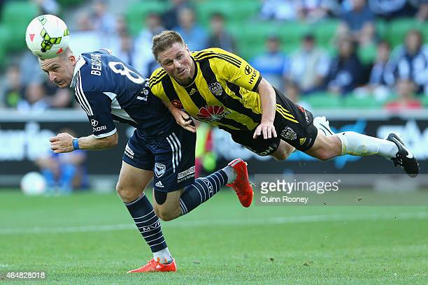 Besart Berisha of the Victory and Benjamin Sigmund of the Phoenix contest to head the ball during the round 19 ALeague match between the Melbourne...