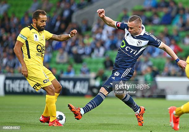 Besart Berisha of the Victory and Diego Castro of the Glory compete for the ball during the FFA Cup Final match between Melbourne Victory and Perth...
