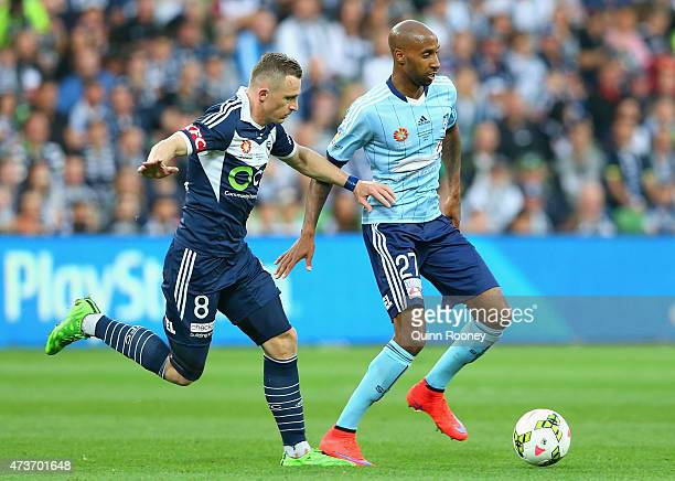 Besart Berisha of the Victory and Mickael Taveres of Sydney FC compete for the ball during the 2015 ALeague Grand Final match between the Melbourne...