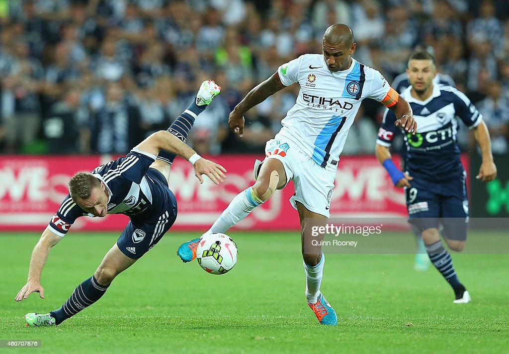 Besart Berisha of the Victory and Patrick Kisnorbo of City contest for the ball during the round 12 ALeague match between Melbourne City FC and...