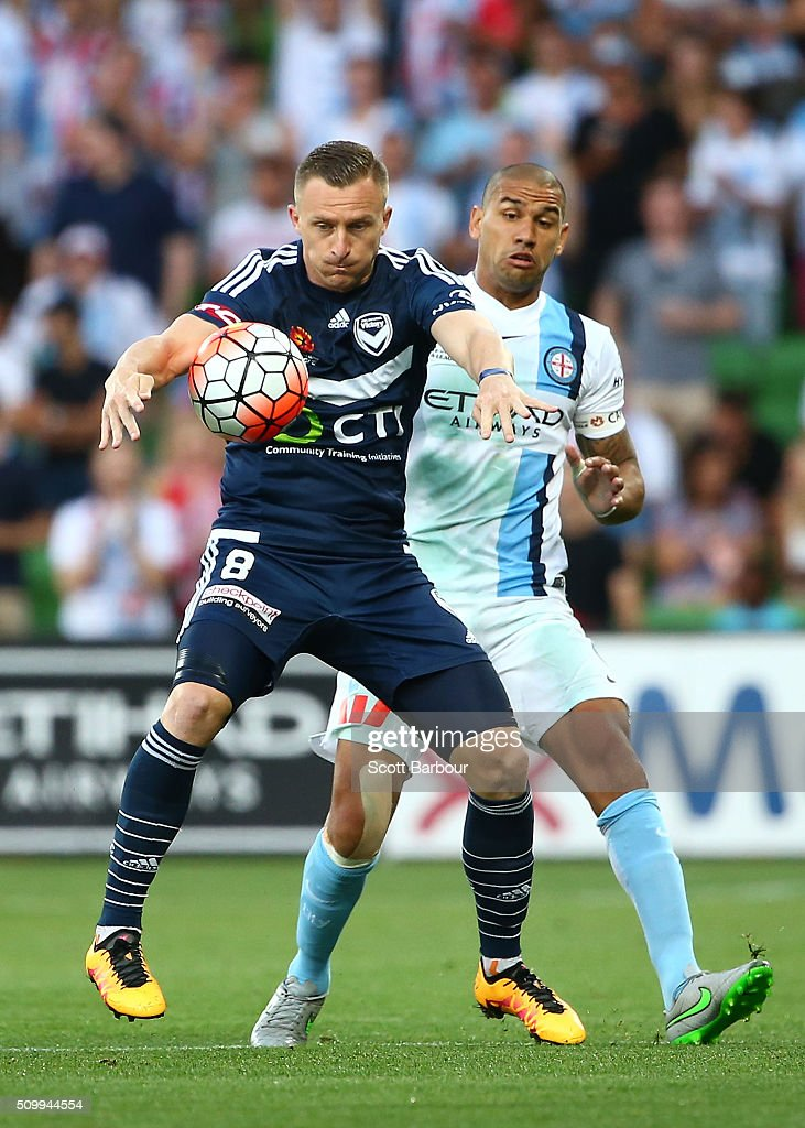 <a gi-track='captionPersonalityLinkClicked' href=/galleries/search?phrase=Besart+Berisha&family=editorial&specificpeople=737057 ng-click='$event.stopPropagation()'>Besart Berisha</a> of the Victory and <a gi-track='captionPersonalityLinkClicked' href=/galleries/search?phrase=Patrick+Kisnorbo&family=editorial&specificpeople=871326 ng-click='$event.stopPropagation()'>Patrick Kisnorbo</a> of City FC compete for the ball during the round 19 A-League match between Melbourne City FC and Melbourne Victory at AAMI Park on February 13, 2016 in Melbourne, Australia.