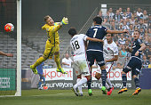 Besart Berisha of the Victory beats goalkeeper Andrew Redmayne of the Wanderers to score the first goal during the round 18 ALeague match between the...