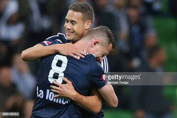 Besart Berisha of the Victory celebrates his 100th goal with Jai Ingham of the Victory during the round 27 ALeague match between the Melbourne...