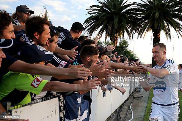 Besart Berisha of the Victory celebrates the win with fans during the round 22 ALeague match between the Central Coast Mariners and the Melbourne...