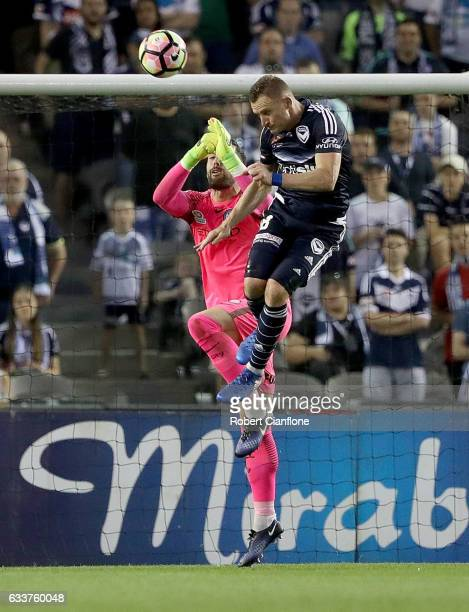 Besart Berisha of the Victory challenges Melbourne City goalkeeper Dean Bouzanis during the round 18 ALeague match between Melbourne Victory and...