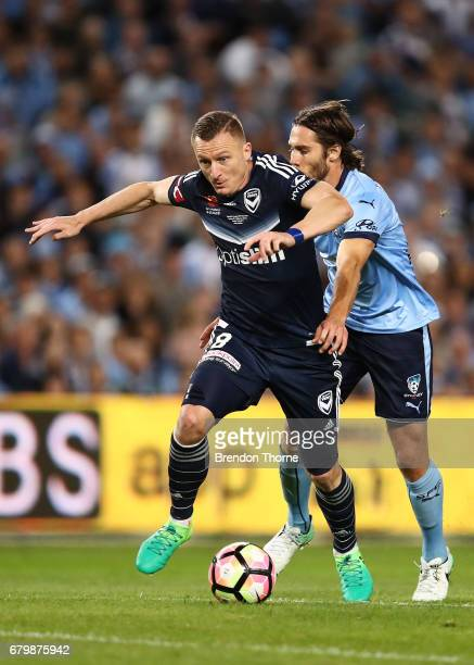 Besart Berisha of the Victory competes with Joshua Brillante of Sydney ball during the 2017 ALeague Grand Final match between Sydney FC and the...