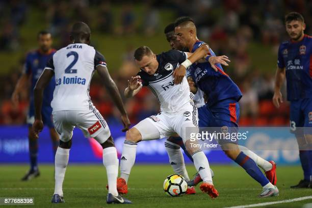 Besart Berisha of the Victory contests the ball with Joseph Champness of the Jets during the round eight ALeague match between the Newcastle Jets and...