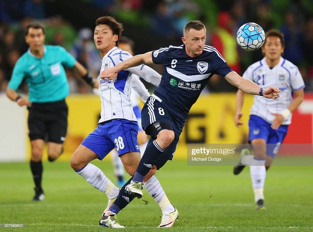 Besart Berisha of the Victory controls the ball against Takahiro Futagawa of Gamba Osaka during the AFC Champions League match between Melbourne Victory and Gamba Osaka at AAMI Park on May 3, 2016 in Melbourne, Australia.