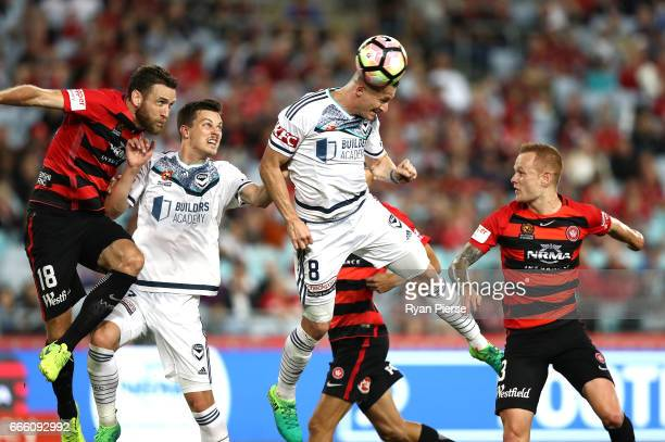 Besart Berisha of the Victory heads the ball during the round 26 ALeague match between the Western Sydney Wanderers and the Melbourne Victory at ANZ...