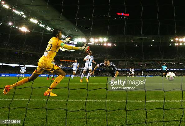 Besart Berisha of the Victory heads the ball past Melbourne City goalkeeper Tando Velaphi to score during the ALeague semi final match between...