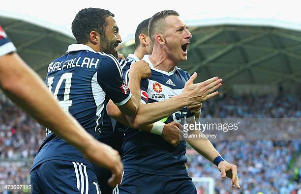 Besart Berisha of the Victory is congratulated by team mates after scoring a goal during the 2015 ALeague Grand Final match between the Melbourne...