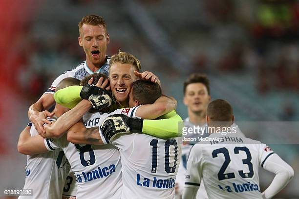 Besart Berisha of the Victory is congratulated by team mates after scoring a goal during the round 10 ALeague match between the Western Sydney...