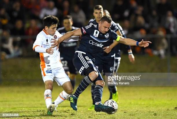 Besart Berisha of the Victory is pressured by the defence during the FFA Cup round of 32 match between the Brisbane Roar and the Melbourne Victory at...